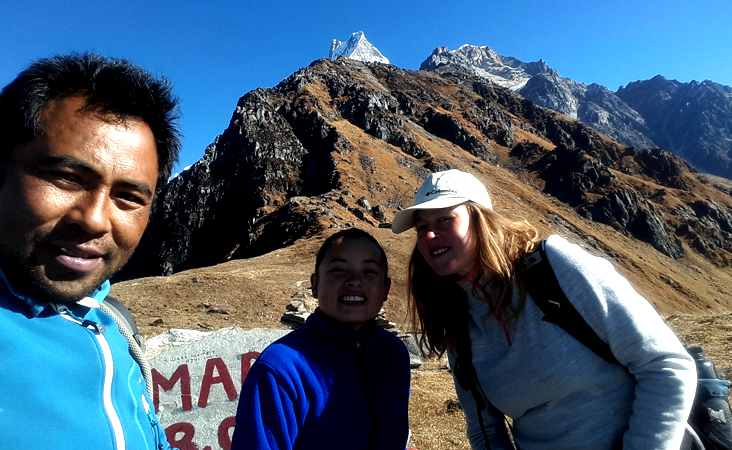 guide minar and customer at Mardi Himal Base Camp, fishtail view