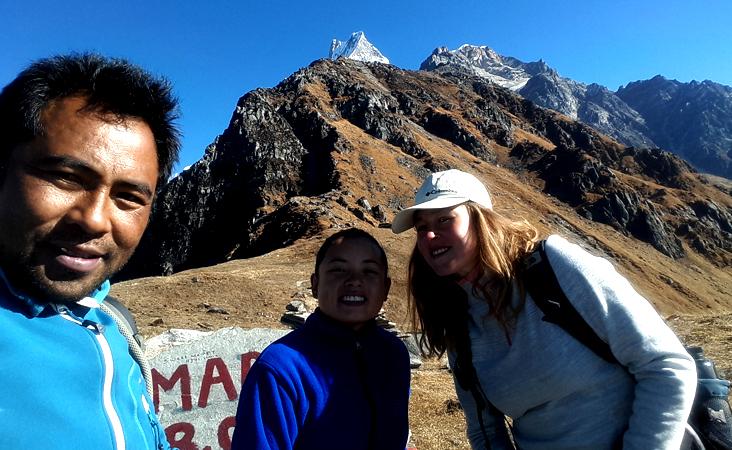 guide minar and customer at Mardi Himal Base Camp, fishtail view